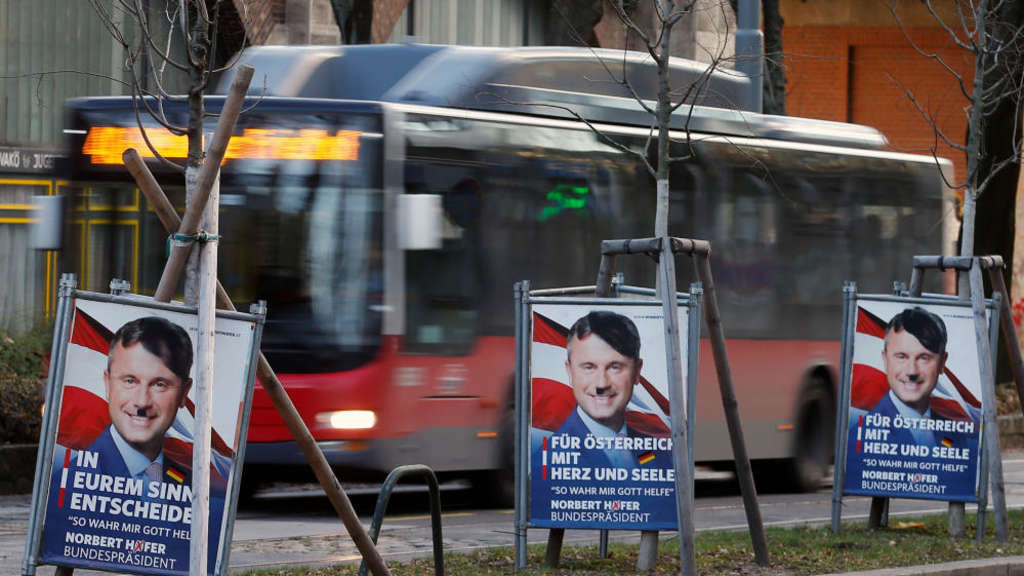 Presidential election campaign posters of the far-right Freedom party (FPOe) candidate Norbert Hofer, defaced to make him look like Adolf Hitler, stand in a street in Vienna, Austria, November 24, 2016. REUTERS/Heinz-Peter Bader