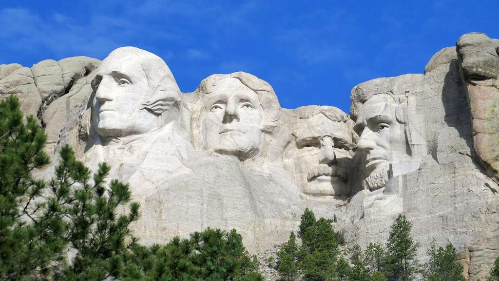 Präsidentenköpfe für die Ewigkeit: Am Mount Rushmore wurden vier Helden der US-Geschichte in Granit gemeißelt (l-r): George Washington, Thomas Jefferson, Theodore Roosevelt und Abraham Lincoln.