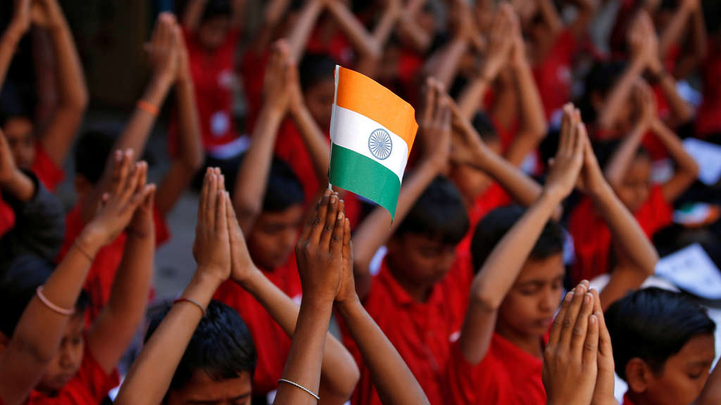 School children offer prayers for the release of an Indian Air Force pilot after he was captured by Pakistan, inside a school in Ahmedabad
