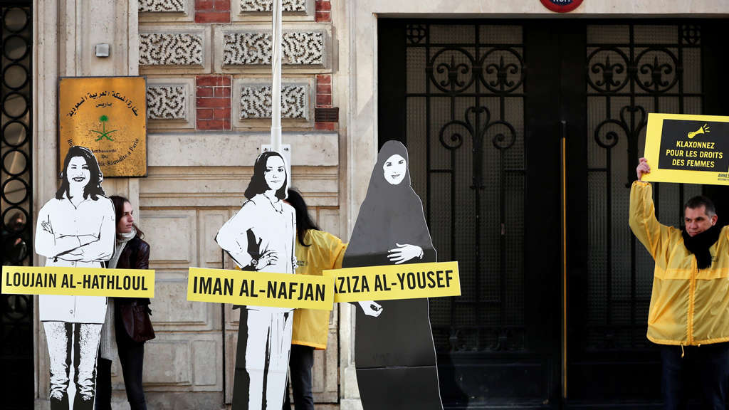 FILE PHOTO: Demonstrators from Amnesty International stage the protest on International Women&#39s day to urge Saudi authorities to release jailed women&#39s rights activists Loujain al-Hathloul, Eman al-Nafjan and Aziza al-Yousef outside the Saudi Arabian Embassy in Paris, France, March 8, 2019. REUTERS/Benoit Tessier/File Photo